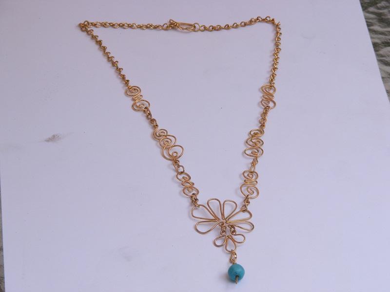 collar flor turquesa